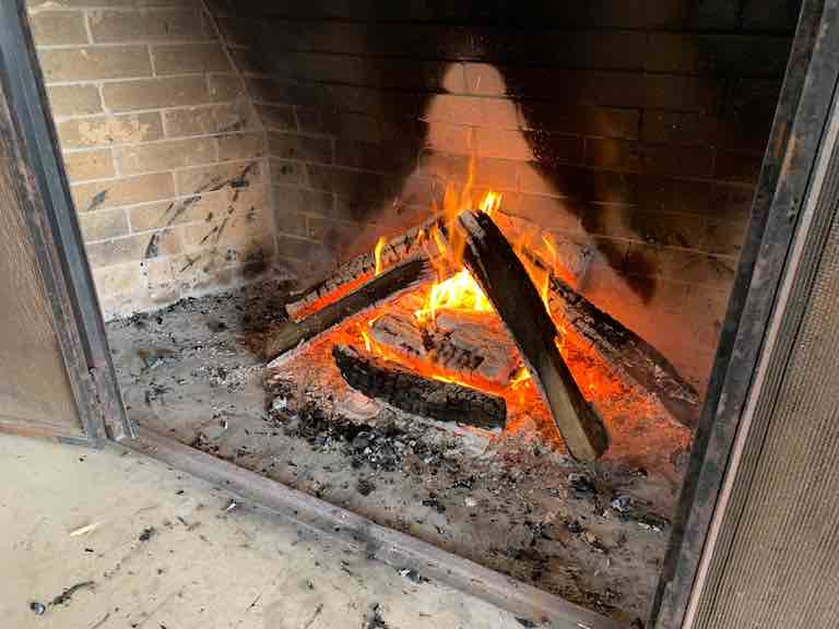 Forest bathing in winter - fire blazing in fireplace