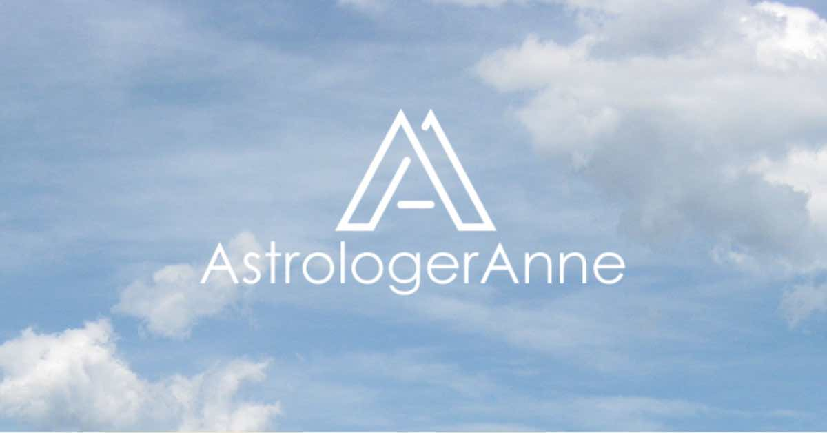 Blue sky with white puffy clouds and Astrologer Anne logo and text